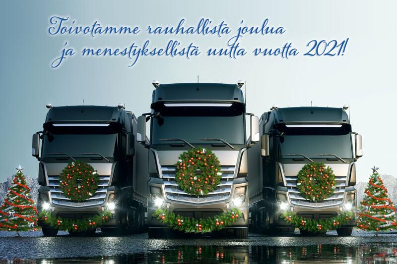"""Kolme jouluseppelein koristeltua harmaata kuorma-autoa ja teksti """"Toivotamme rauhallista joulua ja menestyksellistä uutta vuotta 2021""""."""